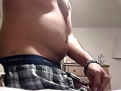 Young sexy Latino showing off big cock