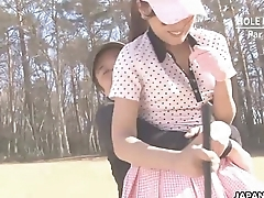 Asian babe gets naked at one's disposal the golf course