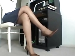 Ebony Milf relaxes her stinky pantyhose hands after a long girlfriend at work.